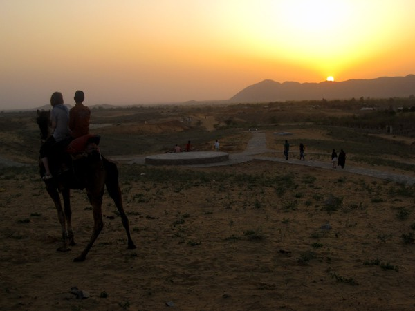 Riding a camel at sunset