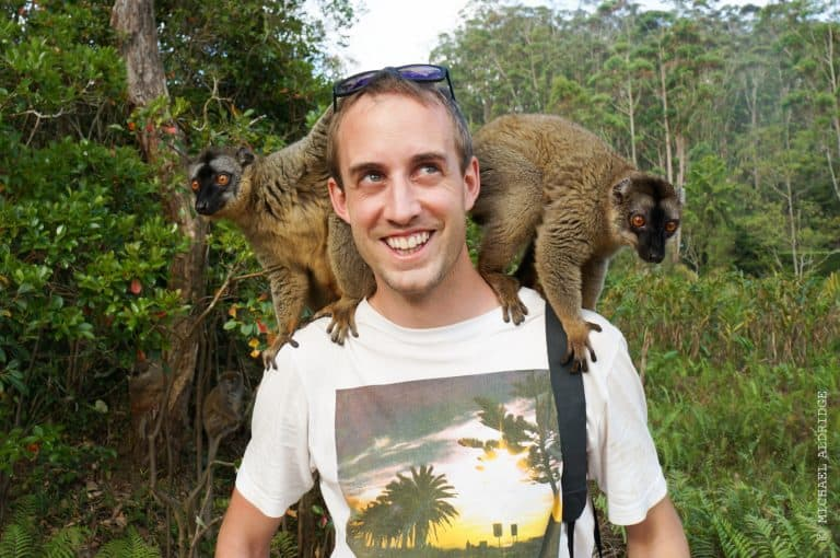 Lemurs climbing on Michael in Madagascar