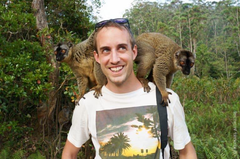 Lemurs climbing on Michael in Madagascar