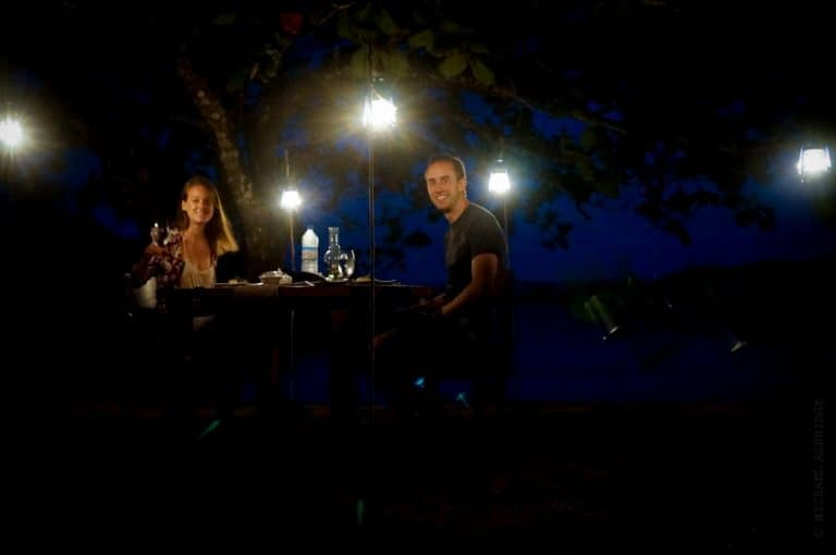 Candle lit meal on the beach