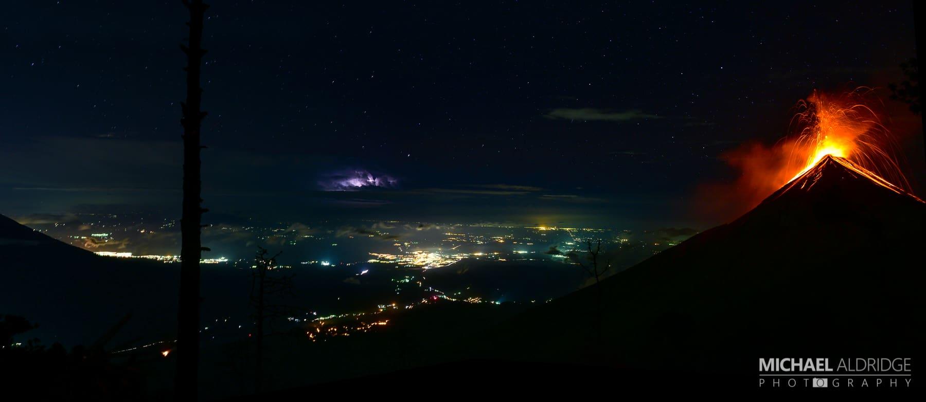 Volcán de Fuego eruption with lightening storm below