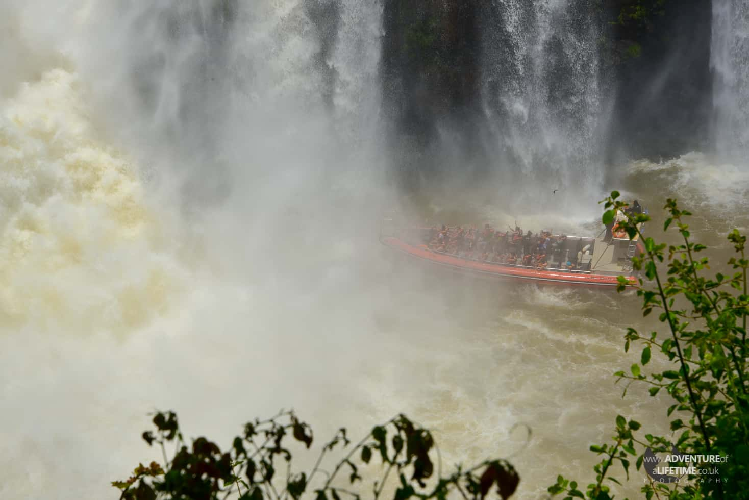 Speed Boat Under The Waterfall