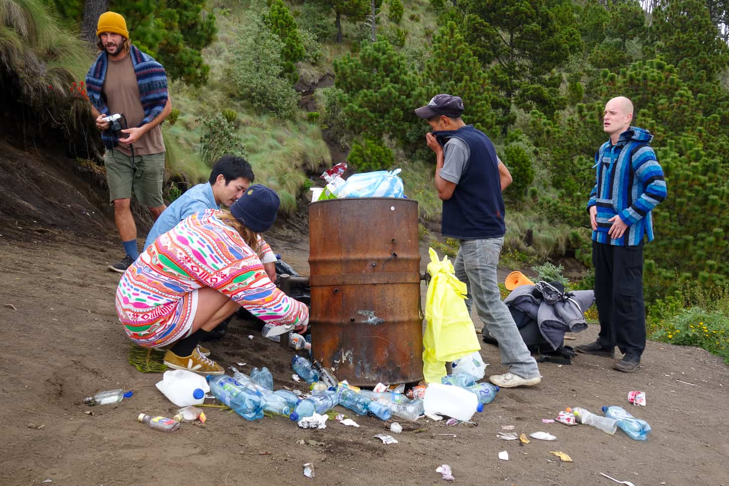 Clearing up the garbage left by other guides at Acatenango Volcano