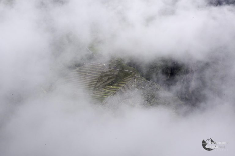 Machu Picchu through the clouds from Huayna Picchu