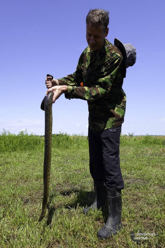 Malcolm holding an Anaconda