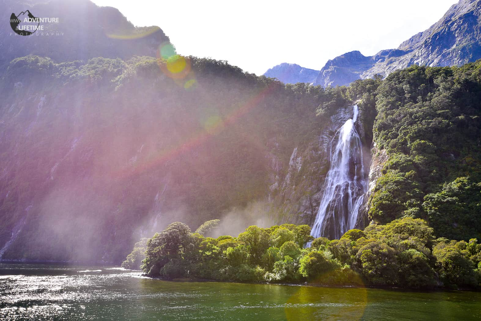 Milford Sounds Waterfall with Sunflare