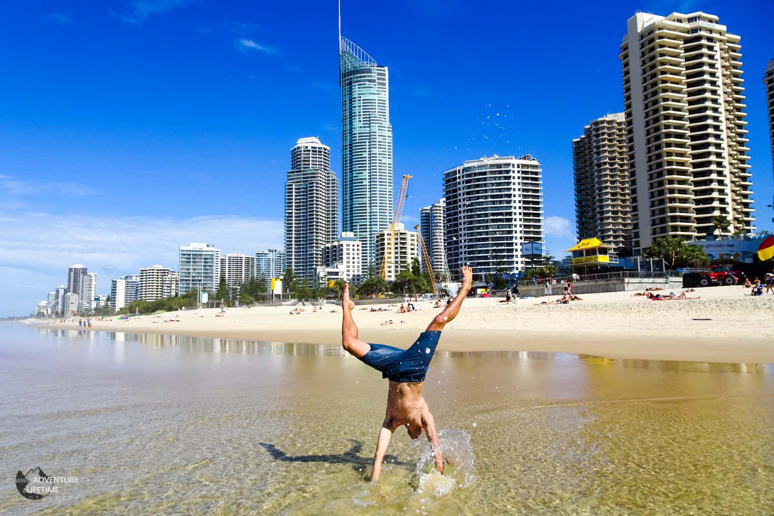 Attempting a handstand at Surfers Paradise