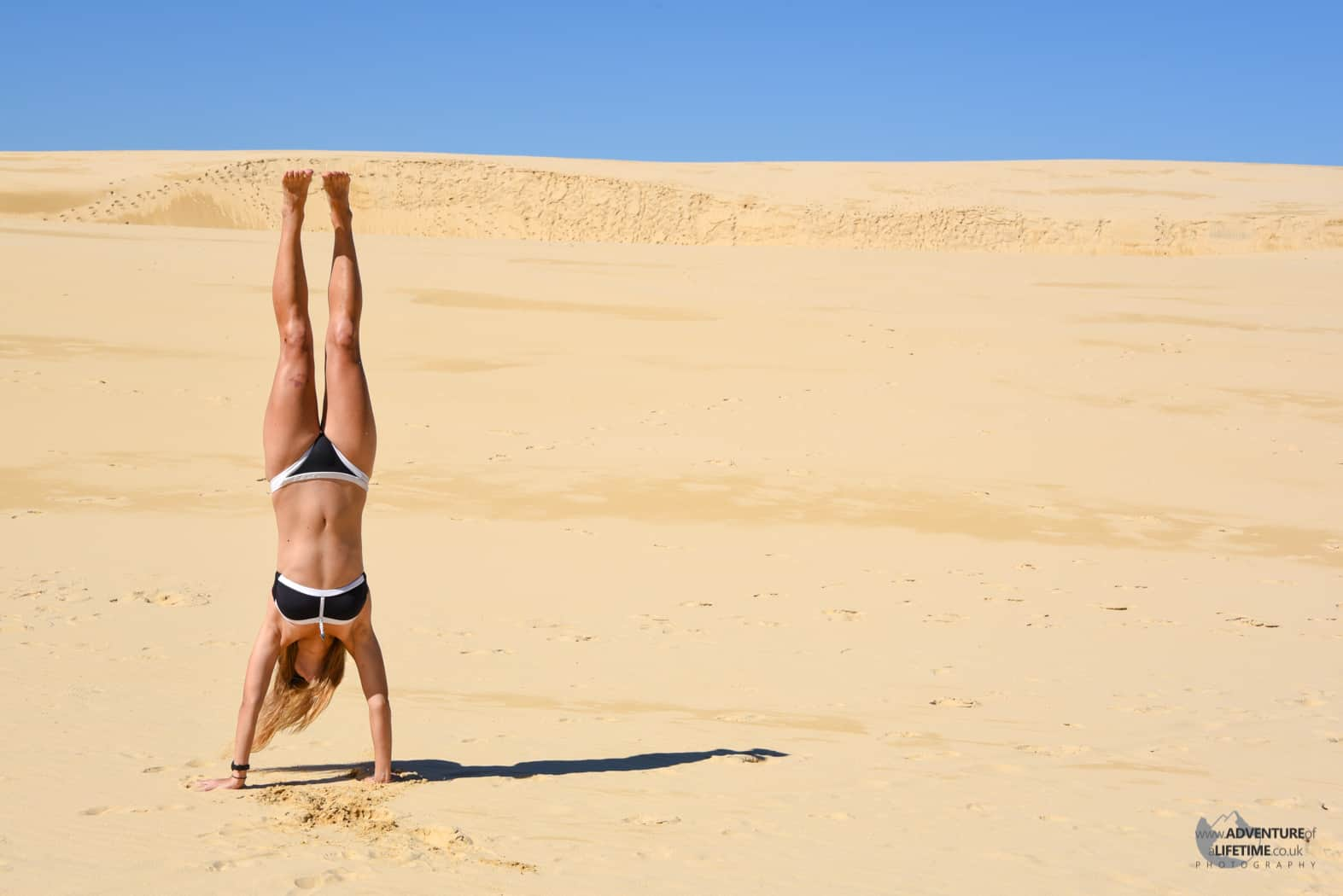 Hand stand on Fraser Island