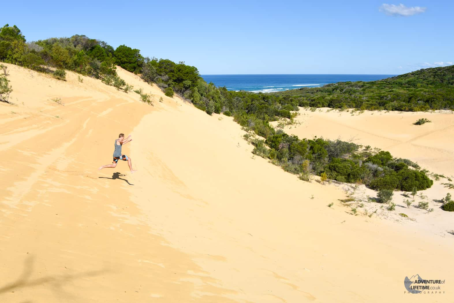 Jumping down a sand dune on Fraser Island