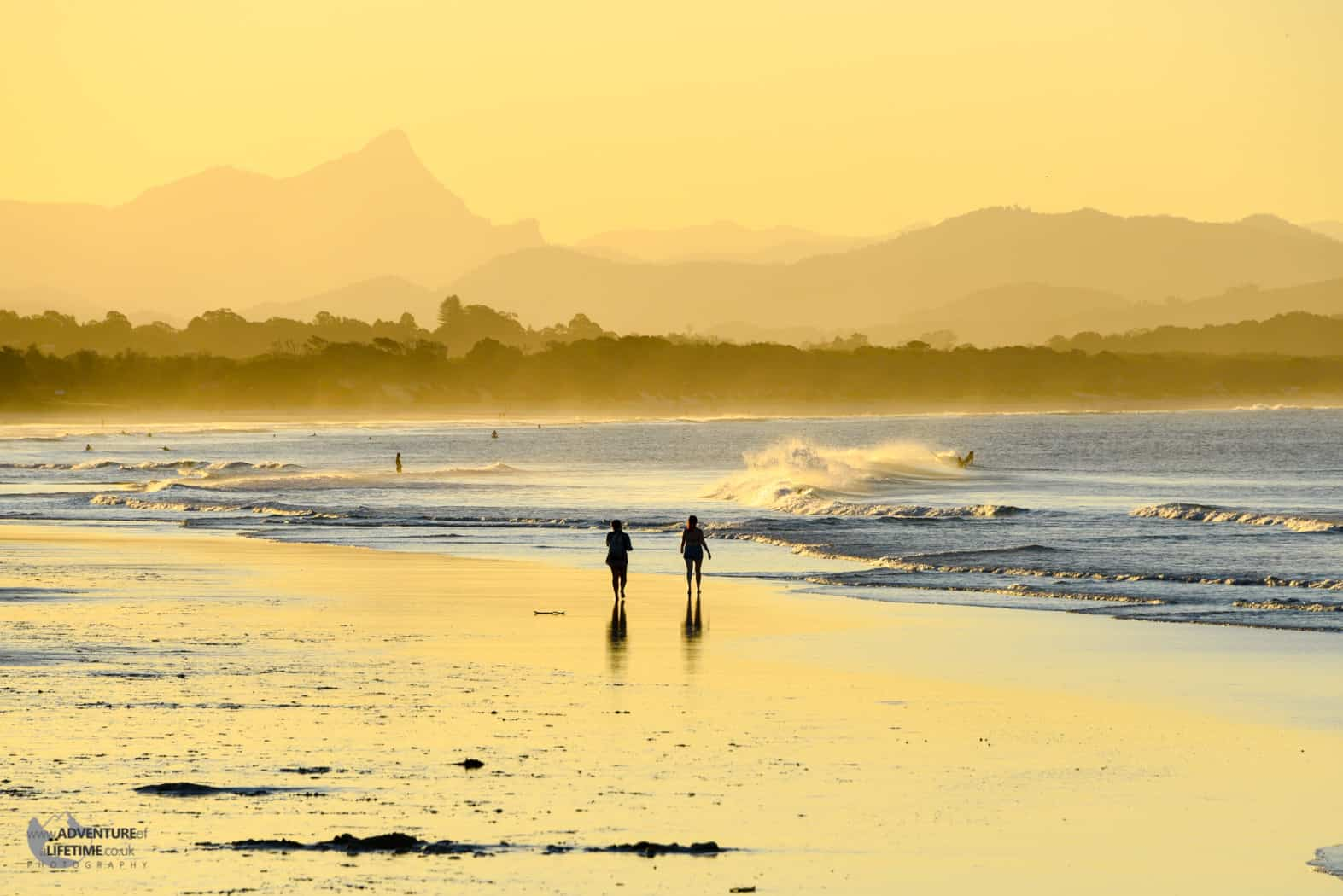 Orange Light of Byron Bay with Mountains