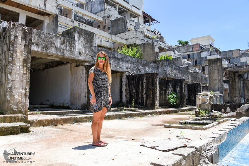 Dora stands in the grounds of an abandoned hotel build at Nai Yang beach