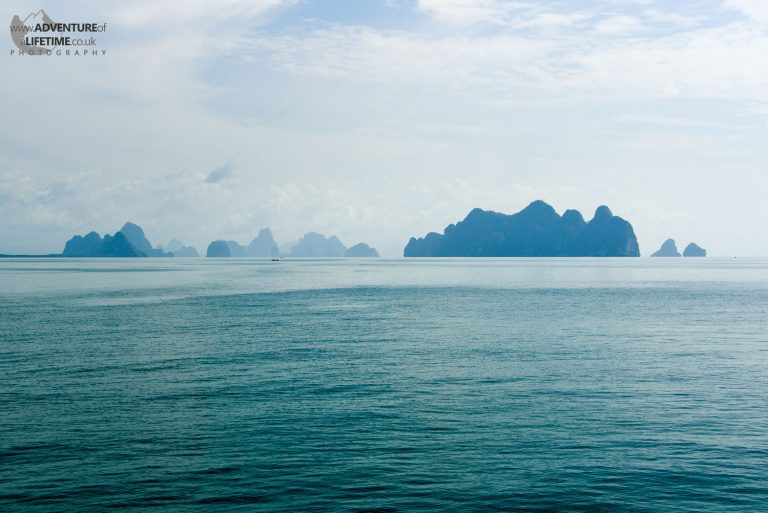 Thailand's Paradise Islands blue in the distance