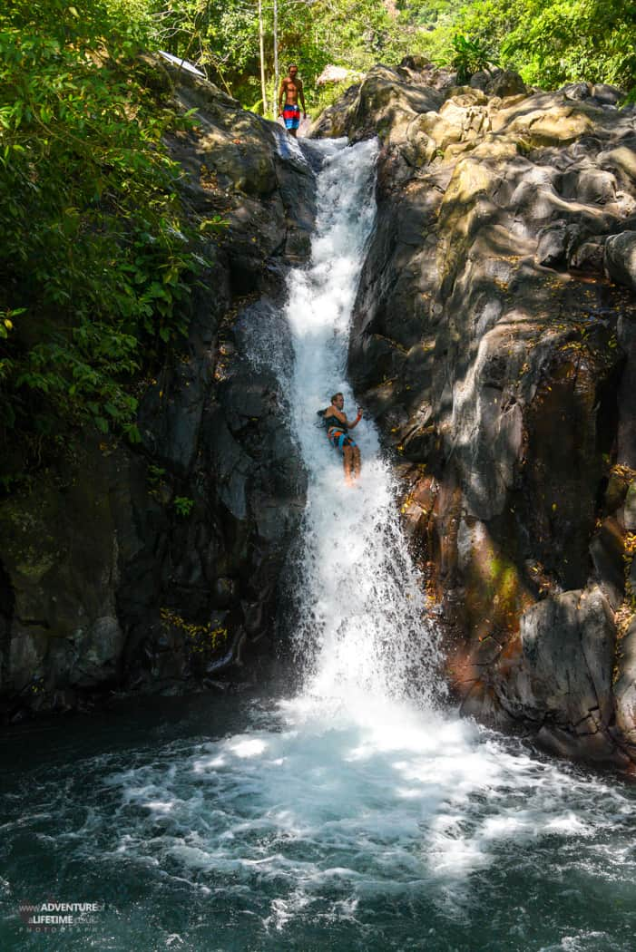 Michael sliding down Aling Aling Waterfall