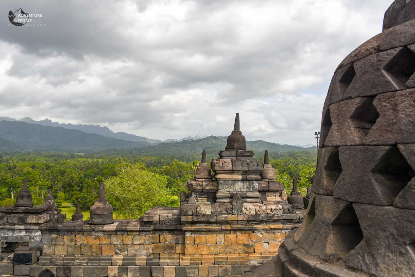 Contrast between Borobudur temple and the jungle