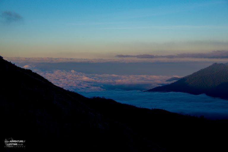 Clouds surround mountains Ijen volcano, Java