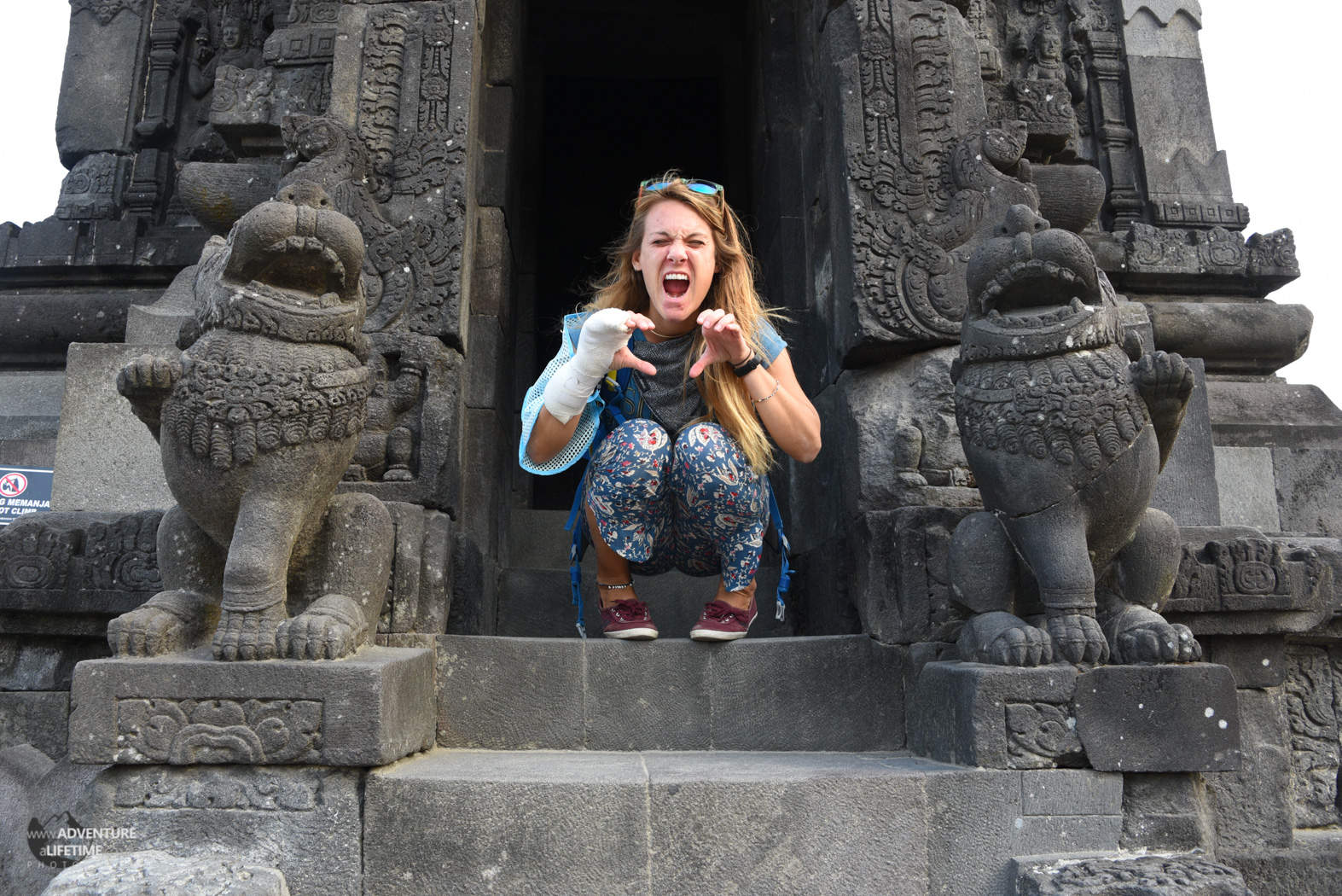 Dora doing her best Gargoyle Impression at Prambanan temple, Java