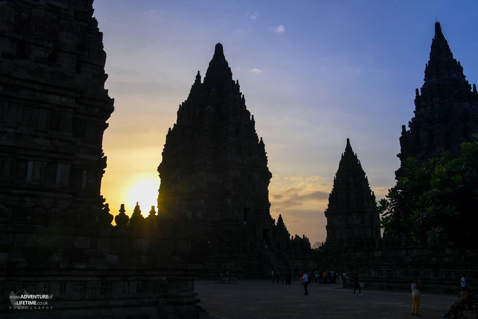 Intricate pillars of Prambanan temple, silhouetted at Sunset