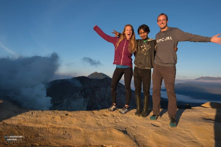 Dora, Michael and their guide at the top of Ijen Volcano, Java