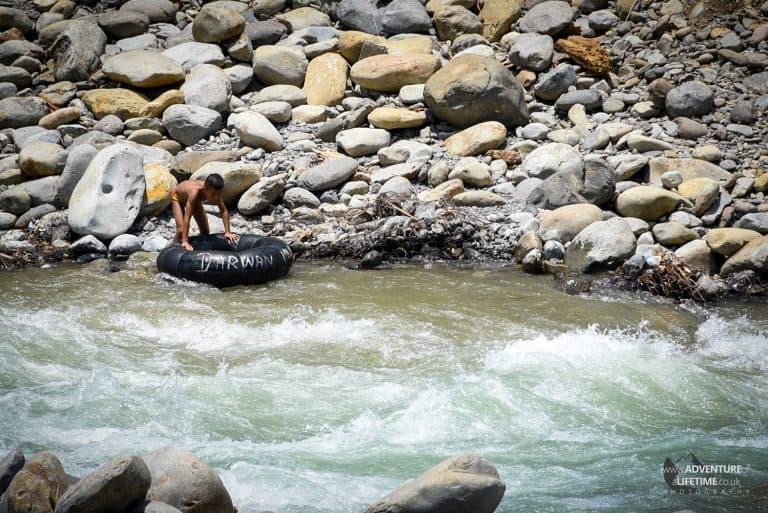 Kid playing in the Bahorok River, Sumatra